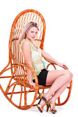 Portrait of a beautiful young blonde in a chair — Stock Photo