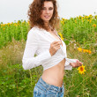 Stock Photo: Beautiful young girl in summer sunflowers