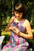 Young pregnant woman and a ring on his finger — Стоковое фото