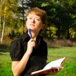Business woman in autumn park — Stock Photo #13863809