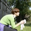 Stock Video: Young woman relaxing after jogging