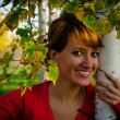 Young woman standing in autumn park under the birch — Stock Photo #14047361