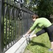 Stock Video: A young woman stretches his legs before jogging