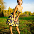Young woman dancing in the autumn park — Stock fotografie #14076677