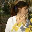 Young woman eating an apple in autumn park — Stock Video #14281141