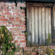 Stock Video: Boarded-up window in brick wall
