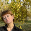 Young woman standing in autumn park under the birch — Stock Video #18102911