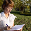 Businesswoman writing in a notebook — Video