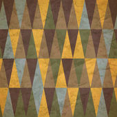 Vintage wzór kolorowe trójkąty zużyty — Wektor stockowy