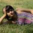 Young pregnant woman lying on the grass in the park — Stock Video
