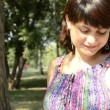 Stock Video: Young pregnant woman in a striped dress