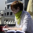 Young woman in a cafe writing in a notebook — Stock Video #20796827
