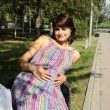 Young pregnant woman sitting on a bench and stroking his stomach — Stock Video