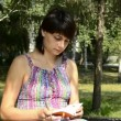 Stock Video: Young pregnant woman leafs through a notepad