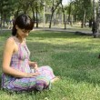 Young pregnant woman in the park, yoga — Stock Video