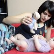 Young mother playing with baby bear — Stock Video