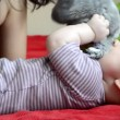 Young mother kissing baby feet — Stock Video