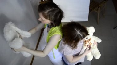 Two pregnant women play with teddy toys — Stok video