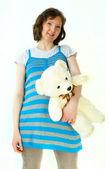 Lady pregnant with teddybear — Stock Photo