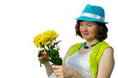 Dorosły kobieta w ciąży z żółty kwiat — Zdjęcie stockowe