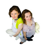 Two pregnant women play with teddy toys — Stok fotoğraf