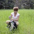 Woman hiker drinking water in summer field — Stock Video