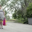 Young pregnant woman is walking in a park talking on the phone — Vidéo