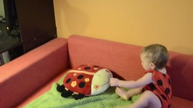 Baby in ladybird costume — Stock Video