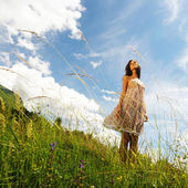 Woman in a flowers field — Stock Photo