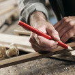 Carpenter Marking a Wooden Plank — Stock Photo