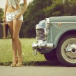 Young sexy girl on the road - Stock Photo