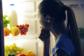 Young woman choosing food — Stock Photo
