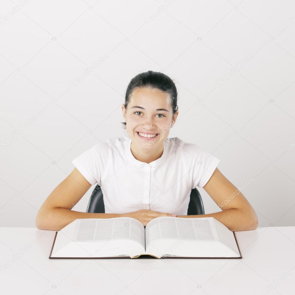 Young girl with book, smiling  Stock Photo #13864188