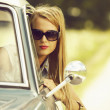 Beautiful young girl in the car. — Stock Photo #14812581