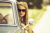Beautiful young girl in the car. — Stock Photo