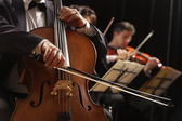 Classical music, cellist and violinists — Stock Photo