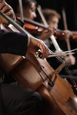 Symphony concert, a man playing the cello, hand close up — Stock Photo