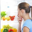 Young woman choosing food — Stock Photo #18048727