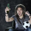 Stock Photo: Football or soccer fan watching television