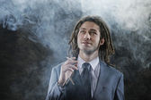 Businessman smoking a joint — Stock Photo