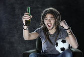 Football or soccer fan watching television — Stock Photo