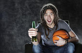 Basketballl fan watching television — Stock Photo