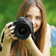 Beautiful young photographer - Stock Photo