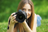 Beautiful young photographer — Stock Photo