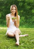 Healthy woman eating salad — Stock Photo