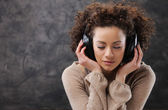 Young woman enjoying music — Stok fotoğraf