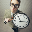 A nerdy guy with a giant-sized clock — Stock Photo