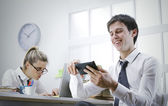 Businessman using smart phone in office — Stock Photo