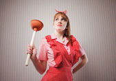 Housewife with plunger — Stock Photo