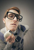 Nerd student shaving with vintage electric shaver — Stock Photo